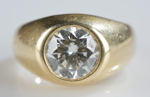 18k yellow gold gent's ring w/ 4.42 carat diamond.