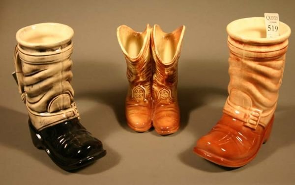 519: 2 McCoy ''7 League Boot'' beer steins; and 1 McCoy