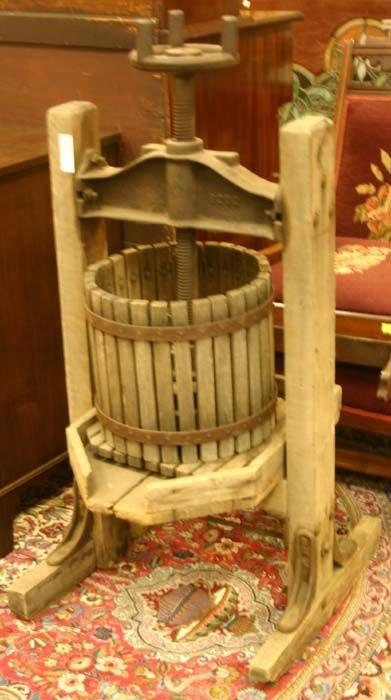 "1001: Cider press, cast iron and wood, impressed ""B202"""