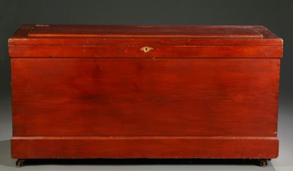 1002: Large red painted dovetailed blanket chest, havin