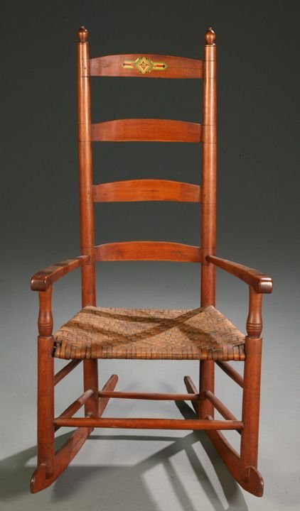 1005: Maple ladder-back rocking armchair with acorn fin