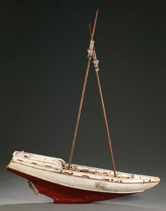 1010: Painted wooden model of a 2-masted boat, having o