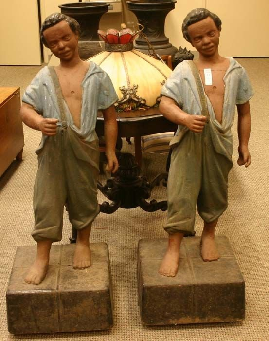 1011: Pair of painted cast-iron black boy pitching post