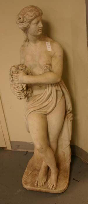 1012: Marble statue of a woman standing, wearing a drap