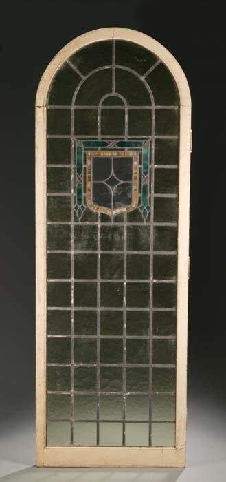 1015: Pair of stained-glass arched doors, having shield