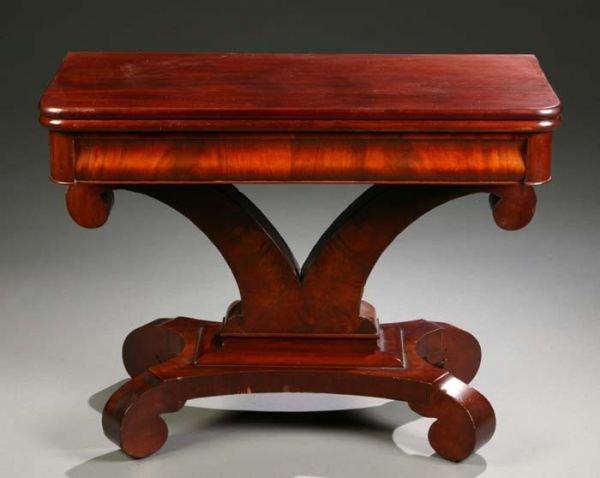 1021: Empire style mahogany veneered game table having