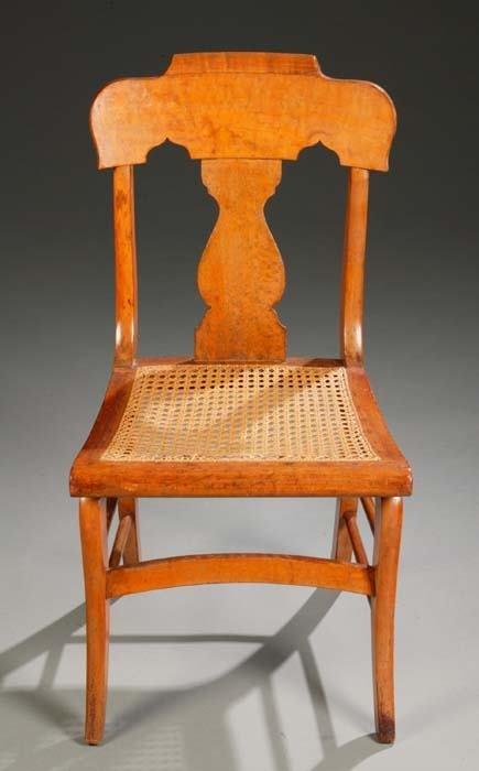 1023: Solid bird's-eye maple side chair having a scallo