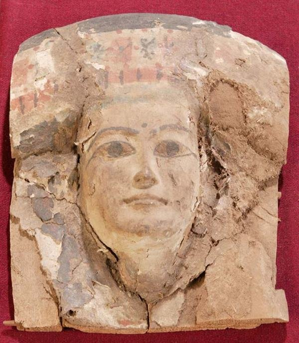 1101: Egyptian painted wood mask, having remnant gesso