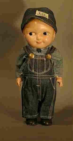 "Buddy Lee Doll, 13"" tall."