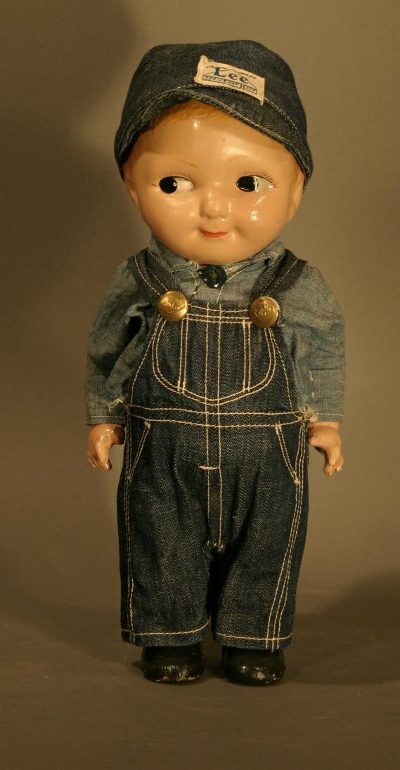 "602: Buddy Lee Doll, 13"" tall."
