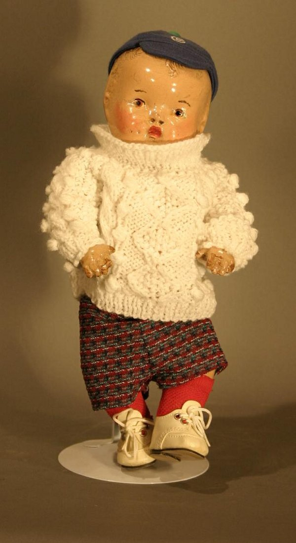 603: 1930's Composition doll.  Painted eyes and hair, s