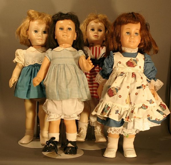 606: Four Old Chatty Kathy Dolls, need repairs.