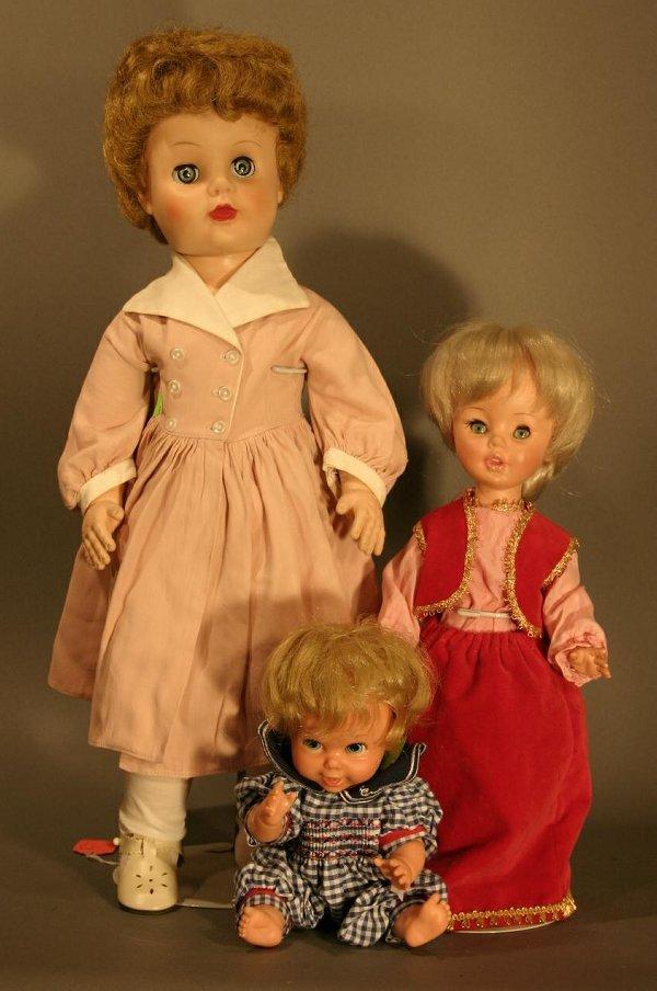 608: Three dolls: Madame Alexander Winnie Walker, hard