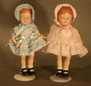 Modern Effanbee Porcelain Patsy Dolls. One blue dr