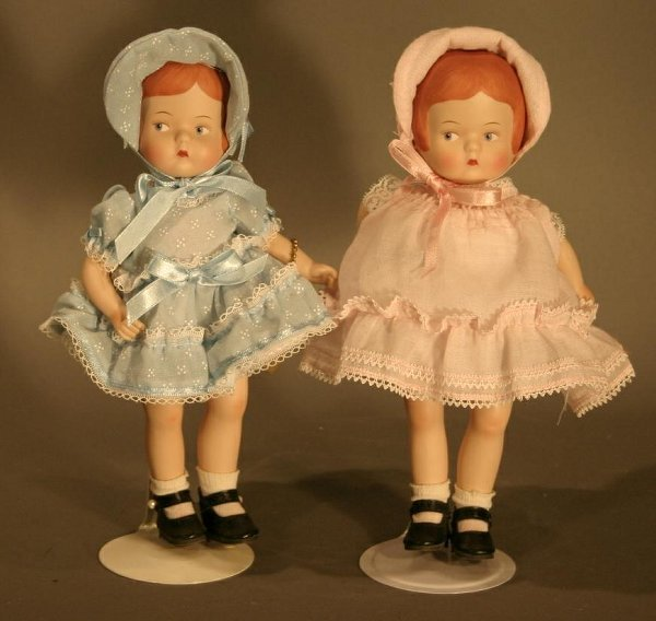 611: Modern Effanbee Porcelain Patsy Dolls. One blue dr