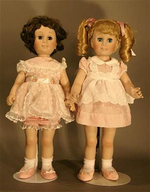 """Two porcelain Chatty Kathy's 17"""" tall."""