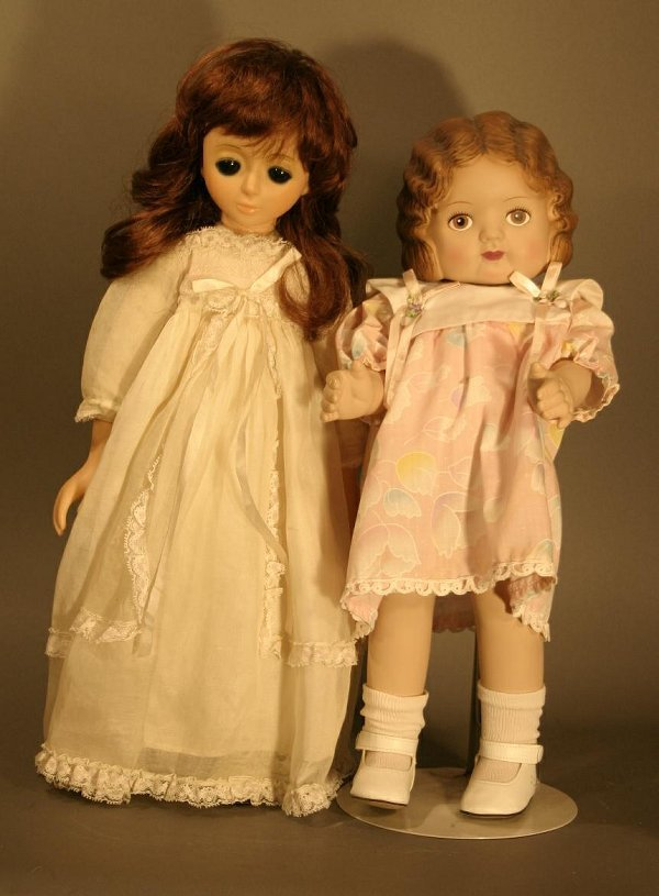 """616: One French plastic and cloth doll, 17.5"""" tall and"""
