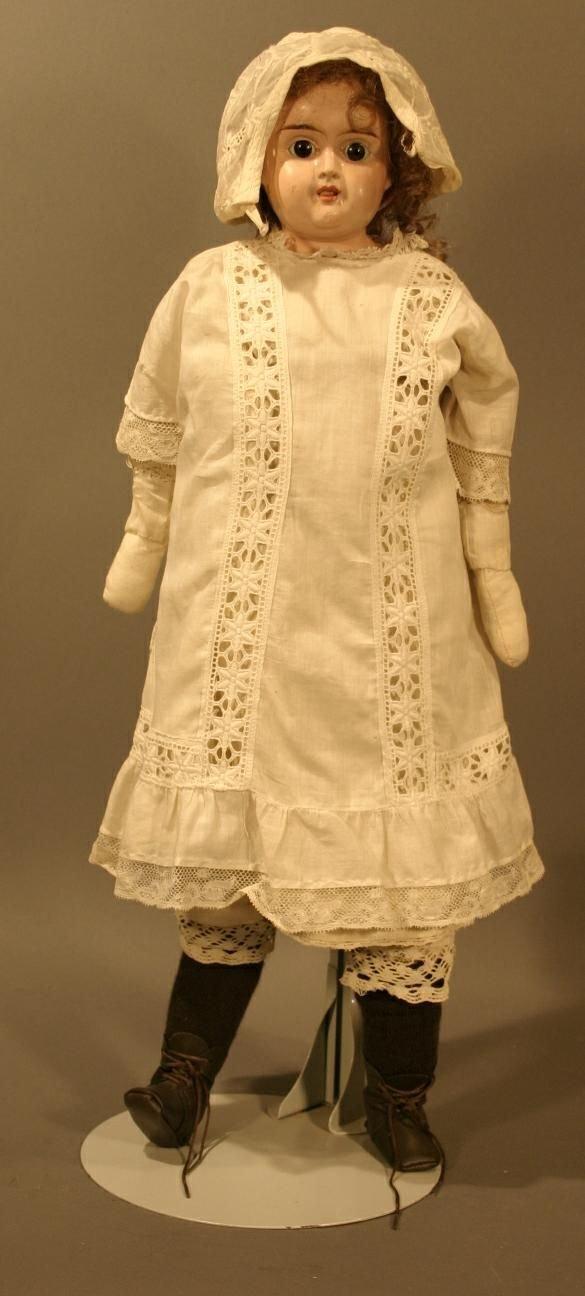 "695: Tin Head Shoulder Neck Doll, marked ""German"" on ba"