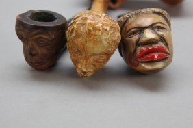 2 Carved Wood Black Figural Pipes + 1 Cane Head