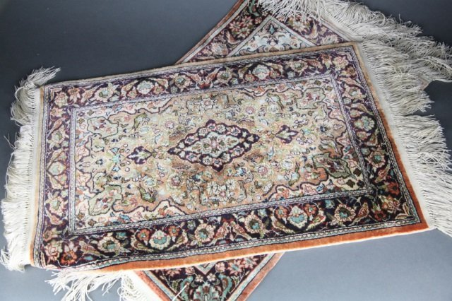 2 small silk Persian rugs.