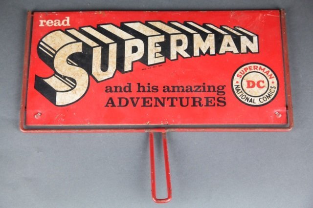 Superman and Batman double sided metal sign.