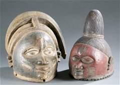 2 Yoruba Gelede society style masks