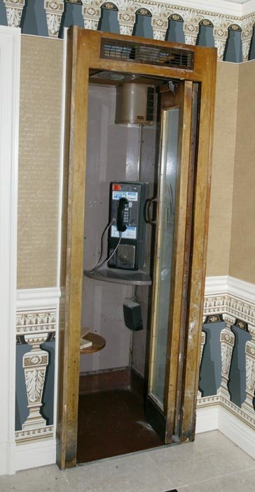 3502: Metal phone booth with wood trim, recessed into w