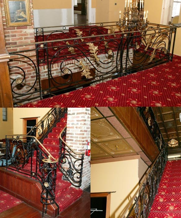 3514: Wrought iron stair railing with top section enclo
