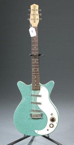 A Danelectro DC-3 turquoise electric guitar, Seria