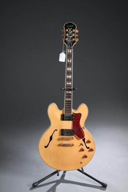 A Gibson Epiphone Sheraton hollow body electric gu