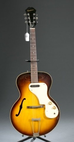 An Epiphone Granada hollow body electric guitar, w