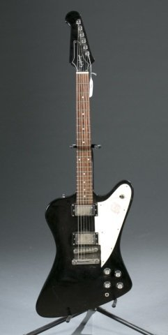 An Epiphone Firebird electric guitar, Serial #: UC