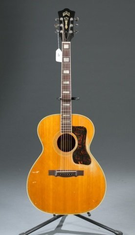 A Guild F47 acoustic guitar, Serial #: AK217. Body