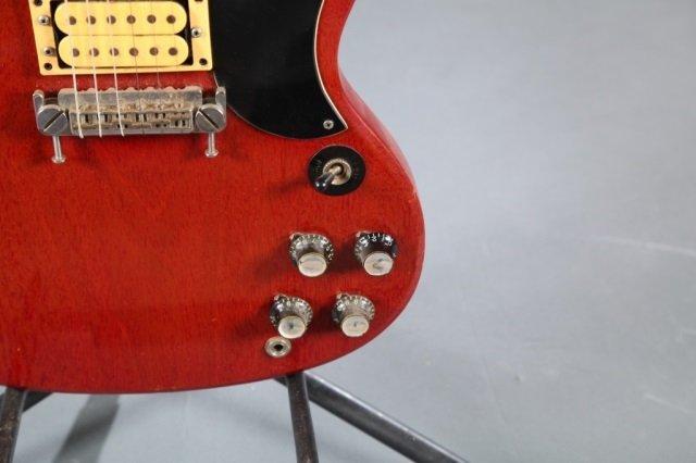 A Gibson SG electric guitar, Serial #: 189898. c.1 - 3