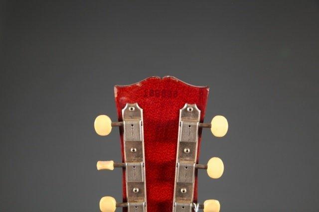 A Gibson SG electric guitar, Serial #: 189898. c.1 - 4