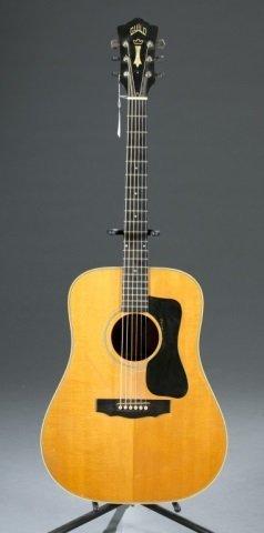 A Guild D50 scoustic guitar, Serial #: 76319. c.19