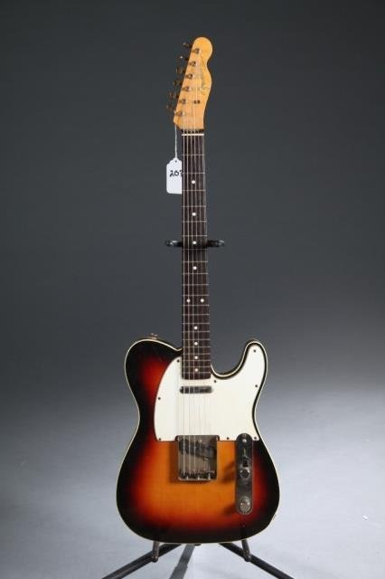 A Fender Telecaster sunburst electric guitar.