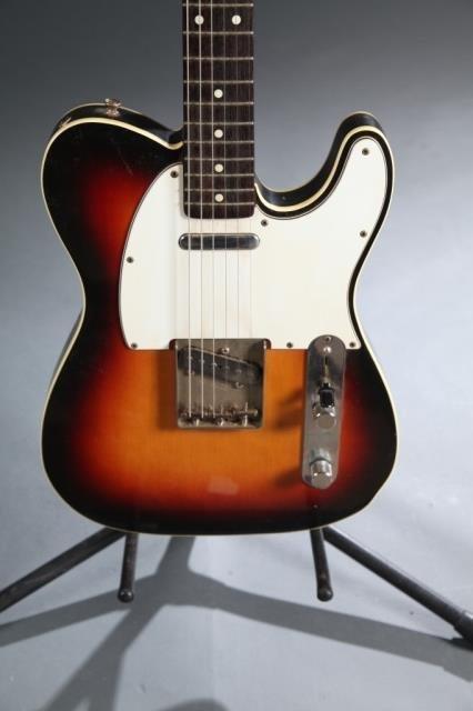 A Fender Telecaster sunburst electric guitar. - 3