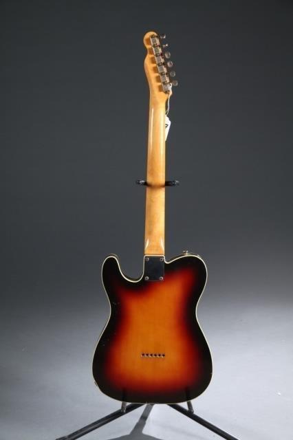 A Fender Telecaster sunburst electric guitar. - 4