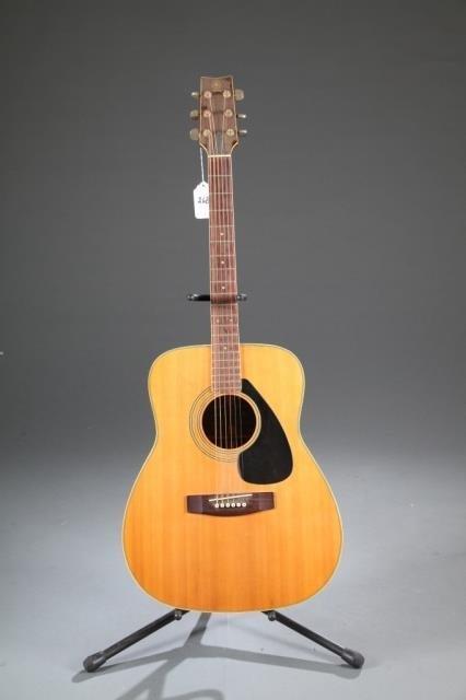 A Yamaha FG-180 acoustic guitar.