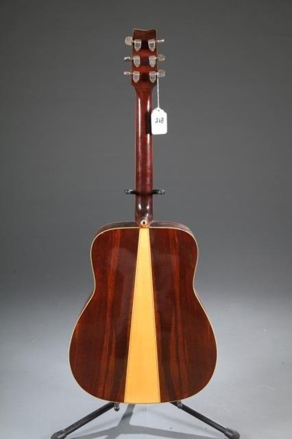 A Yamaha FG-180 acoustic guitar. - 2