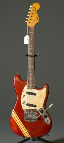 A Fender Mustang electric guitar with tremolo. Ser