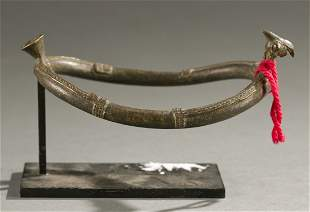 West African brass armlet, 20th century.