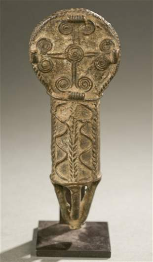 West African brass object, 20th century.