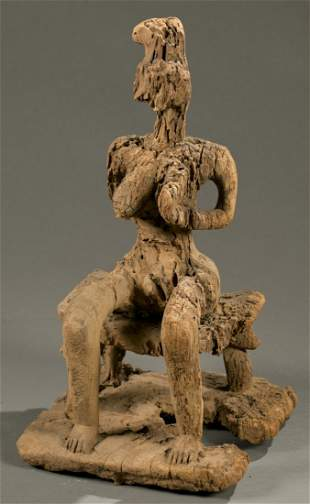 West African seated female figure, 20th c.