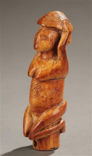 West African ivory female figure finial.