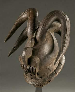 West African horned helmet mask, 20th century.