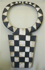 Horned plank mask with checkerboard design.