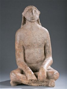 Niger Delta seated clay figure. 15th - 17thc.