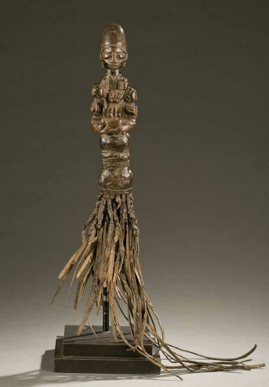 Yoruba flywhisk with equestrian figure.